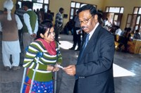CMD, NHFDC guiding a disabled girl for interview with Corporate during Job Fair for Persons with Disabilities organized by NHFDC at War Heroes Memorial Stadium, Ambala Cantt on 14.11.2013.